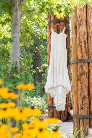 Romantic Lace Wedding Dress Hanging at Larkspur Wedding Venue