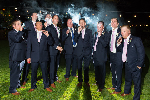 groomsmen with cigars during reception at the barn at raccoon creek